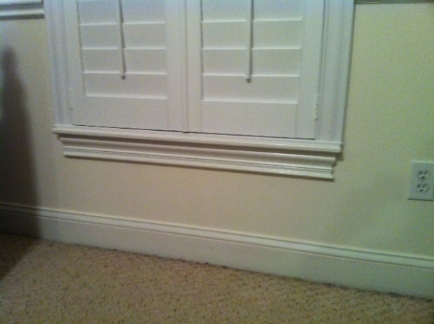 Lower Cabinets Upper Bookcases Flanking Window Seat