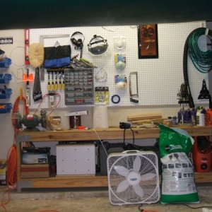 My too short work height wise workbench, and peg board. I have been busting my behind trying to get everything clean and organized, my wife has been w