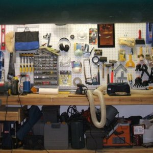 My workbench with the right length legs, and tools stashed. The sander is hooked up because I am working on refinishing cabinets and doors...