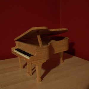 Red oak piano.  Even the keys are hand cut.  Compound cuts for the legs.