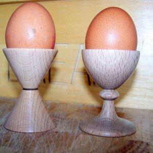 Egg cups in beech.  Finished in Melamine laquer on top of cellulose sanding sealer