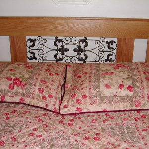 Red Oak Queensize Headboard with a wrought iron insert purhcased at local Kirklands.