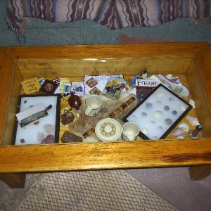 It not a good photo, but it is a shadow box coffee table with glass top. materials include a glued together panel bottom, 3 x 3 legs, spf 1 x 6 1/4&qu