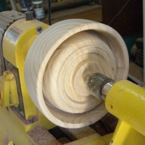 "Blank reversed, 5/8"" groove cut with gouge, second bowl rough shaped again forming spigot for chuck"