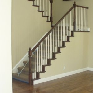 maple flooring stined with staircase to match.