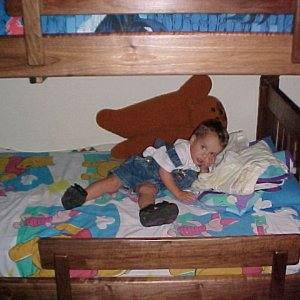 Finished bed, Then, youngest Grandson staking claim for bottom bunk. Mom said big brother on top!