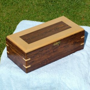 KEEP SAKE BOX. BOCOTE WITH A MAPLE FRAMED TOP AND MAPLE KEYS IN CORNERS. NO SCREWS OR NAILS, EVERYTHING IS TONGUE AND GROOVE OR HELD WITH THE KEYS INS