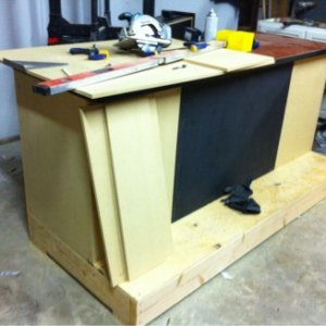 Started with a desk top with 2-drawer cabinet(black center section). Then built around it.