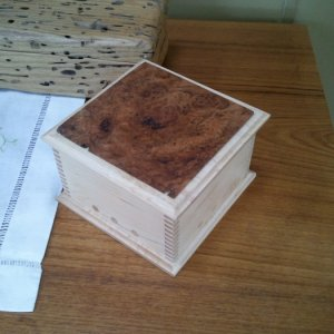 Small box I made for my dad.  The cherry burl on top came from his property.