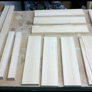 The lumber cut into the 12 parts that comprise the chair.