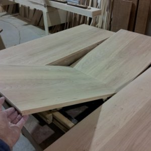 This center section folds on a pair of SOSs hinges, then flips and stores under the table. Neat huh.