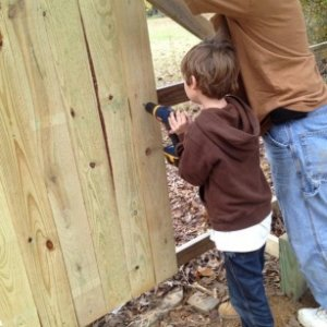 Me and my nephew building a privacy fence.