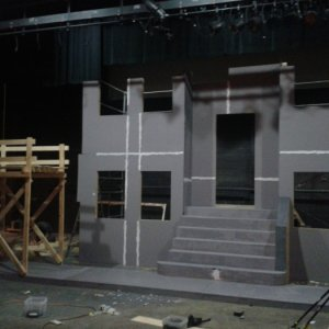 "This is set work for ""A streetcar named desire"" I think. 16'-18' tall walls that ran 20' to 26' across with workable doors, windows and seco"