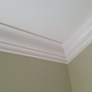 Standard crown molding inside corner with colonial molding, mitered.