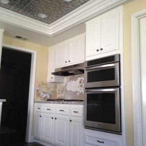 This was a kitchen reface, but the crown is in the light box where we replaced the fluorescent box with ceiling tiles and molding.