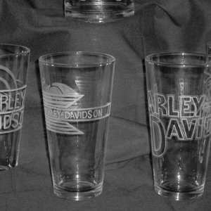 Pitcher & 4 glasses - Harley Davidson Vintage logo's set.  The pitcher has the 1st logo of Harley Davidson and the glasses represent the logo's an