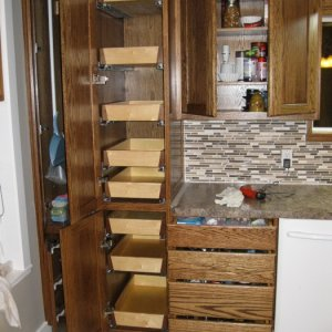 After replacing the drawer glides my pantry trays will open without hitting the door.