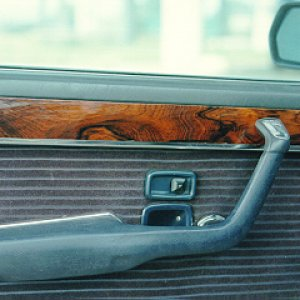 BMW Wood was originally Mahogany and fairly plain.  Replaced all the wood in the car with Matto Grosso Brazilian Rosewood and clear coated with cataly