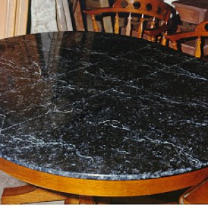 Faux Marble Table Top is actually Red Oak.  A customer wanted the top of her table to look like marble so I primed and filled the pores, then paid my