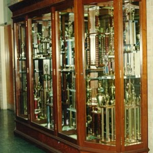 Walnut and Walnut Burl Trophy Case for Caddo Magnet High School.  Built in three sections, finished in nitrocellulose lacquer.