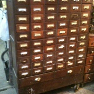 My grandfather's card catalog that he used for his plumbing business, now the home for all my loose screws.