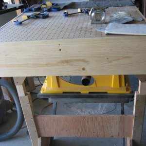Downdraft table - nothing fancy, but it keeps the dust down quite a bit.  It sits nicely balanced on top of table saw and outfeed support