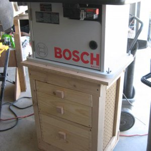 Rolling Router Table - built for the router but the bandsaw (or other benchtop tool) can easily be clamped to it.  The drawers are all dovetailed, goo