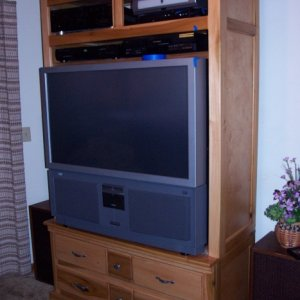 TV cabinet, used large caster so the whole unit can be rolled around and easy access to back for connections.  Projection TV is very heavy.