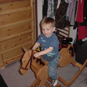 My youngest grandson Timmy riding the hobby horse I made him for Christmas.