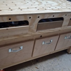 Drawer fronts and pulls installed on the deep drawers