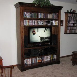 "New Entertainment Center.  84"" high, 60"" wide, 17"" deep. Maple veneer and solid maple."