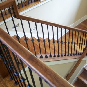 The handrails, newel post, stairs treads and risers were made from reclaimed heart pine from over 100 yrs old barn. This was all milled and hand made