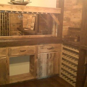 10'x14'  Wine Room. The walls were covered with skip planed reclaimed red oak as well as the cabinets, the counter tops were man made stressed pine to