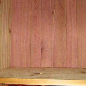 "Close up of red cedar wedged into bottom.  Base is 1/4"" birch plywood in dadoed grooves along all side."