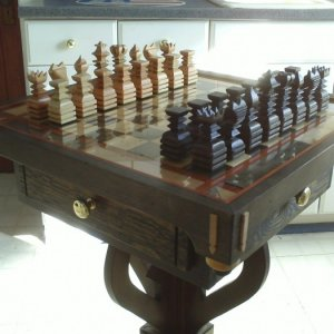My 2nd Chess Set Design........Solid Maple Pieces & Squares. Two drawers to hold pieces/Two dummy drawers,Glass top/removable game board