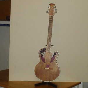 1/2 scale replica of a friends guitar made out of plywood and pine