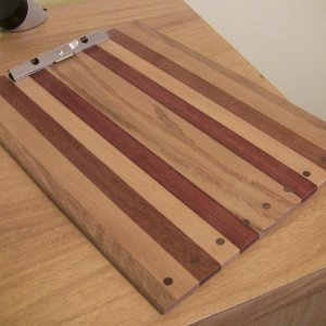Clip board.  Gift for my sister.  Oak, cherry, mahogany, maple, jarrah, and oak, with black walnut plugs.