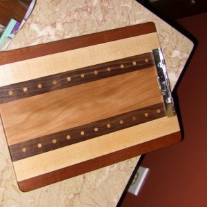 My third clipboard.  Mahogany, maple, black walnut, and sycamore, with almond plugs.  I didn't really like how this design came out; it looks kind of