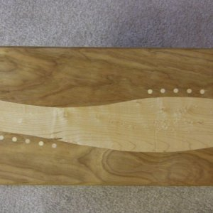 Detail up of the top, cherry and birds-eye maple.