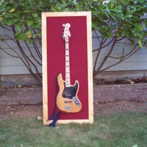 A wall frame/holder for my bass, basically just a piece of plywood with a pine frame and some quilted maroon fabric