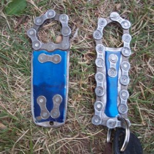 not woodworking related but sick none the less! Bike chain bottle opener, I had to cut them by hand so they are a little sloppy, but the one on the ri