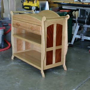 Convertible changing table with open shelves. Quarter sawn white oak and mahogany.