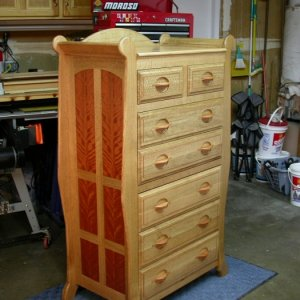 This dresser features quarter sawn white oak with mahogany veneered side panels and inlaid accents. The sleigh style dresser was made to complement th