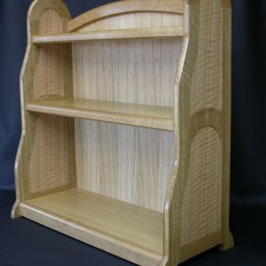 This toddler bookcase is designed to minimize tipping with its short profile and wide base. The curved frame and panel sides offered an interesting de