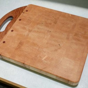 This is a cutting board I made as a 2010 Christmas present for my son's girlfriend.  It's end-grain maple with a cherry handle.