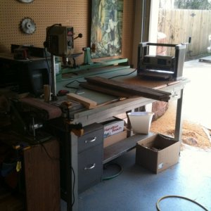 My cluttered work drafting table/workbench