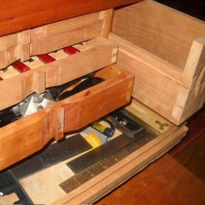 Cherry tool box drawer dovetails were hand made with dovetail saw, mallet and chisels.