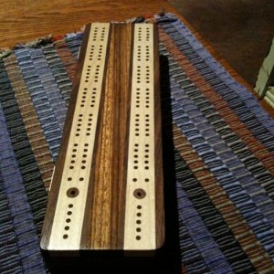 I made a couple of cribbage boards, but this is the only one I have a picture of.  Black walnut, maple, and zebrawood.